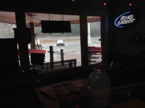 """...and started tipping it down (I know, you can't see it very well but I thought you might like the """"Bud Light"""" sign :o))"""