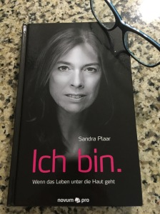 Book cover with photo of author.